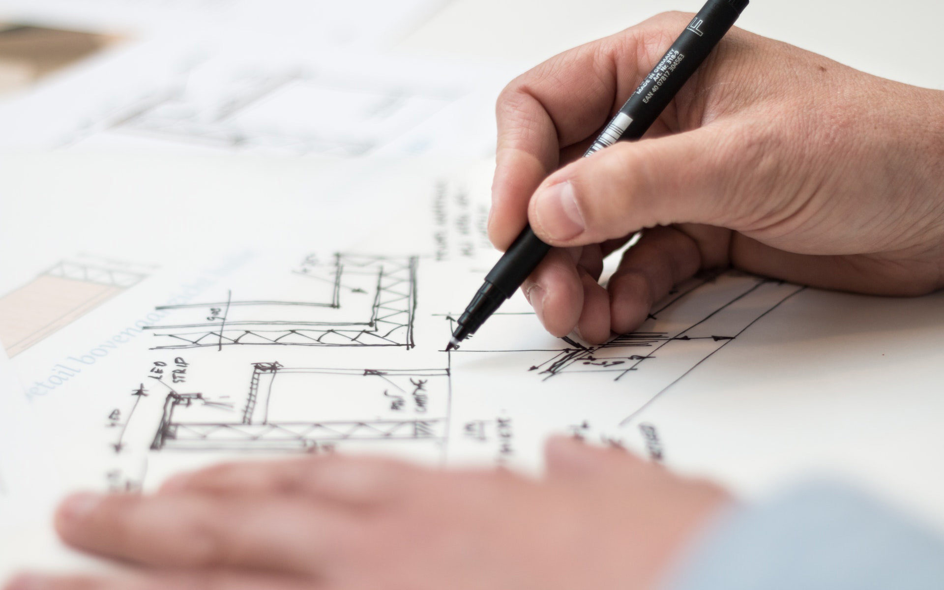 Pen and house blue prints
