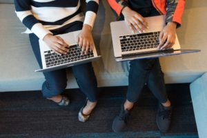 Two people working on their laptops
